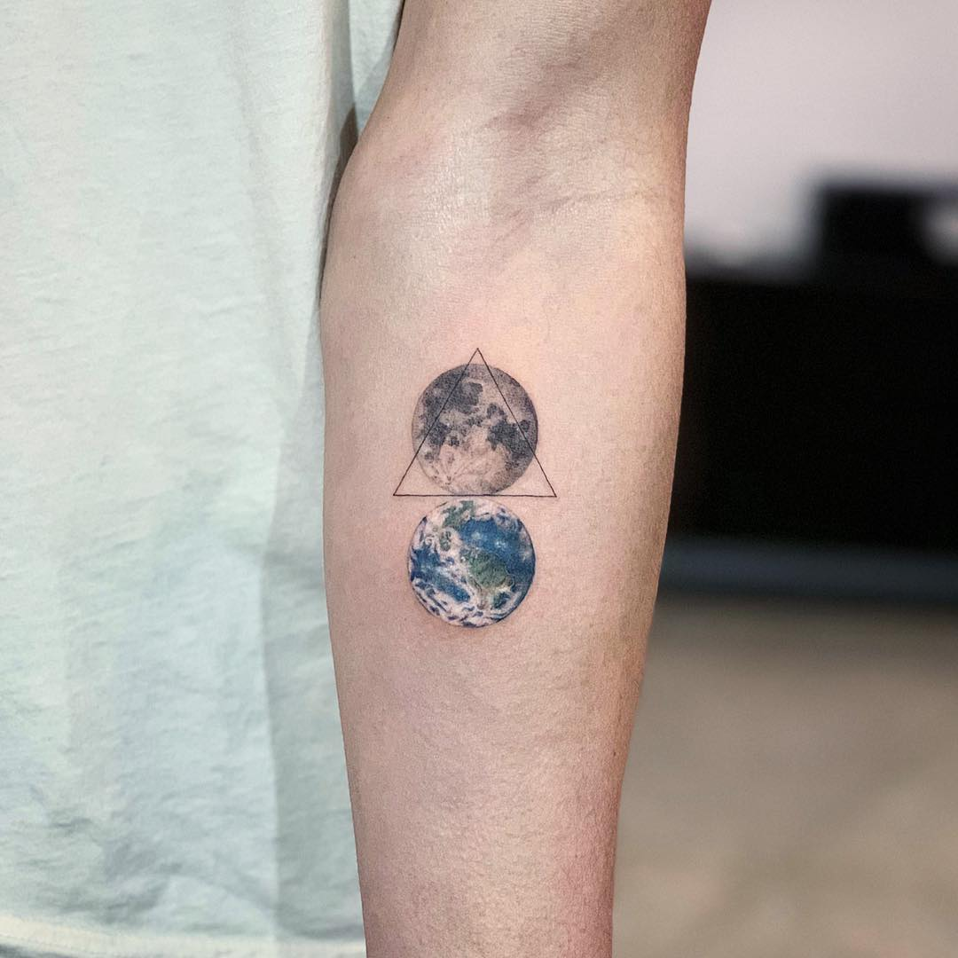 Moon and Earth tattoo by Dragon Ink