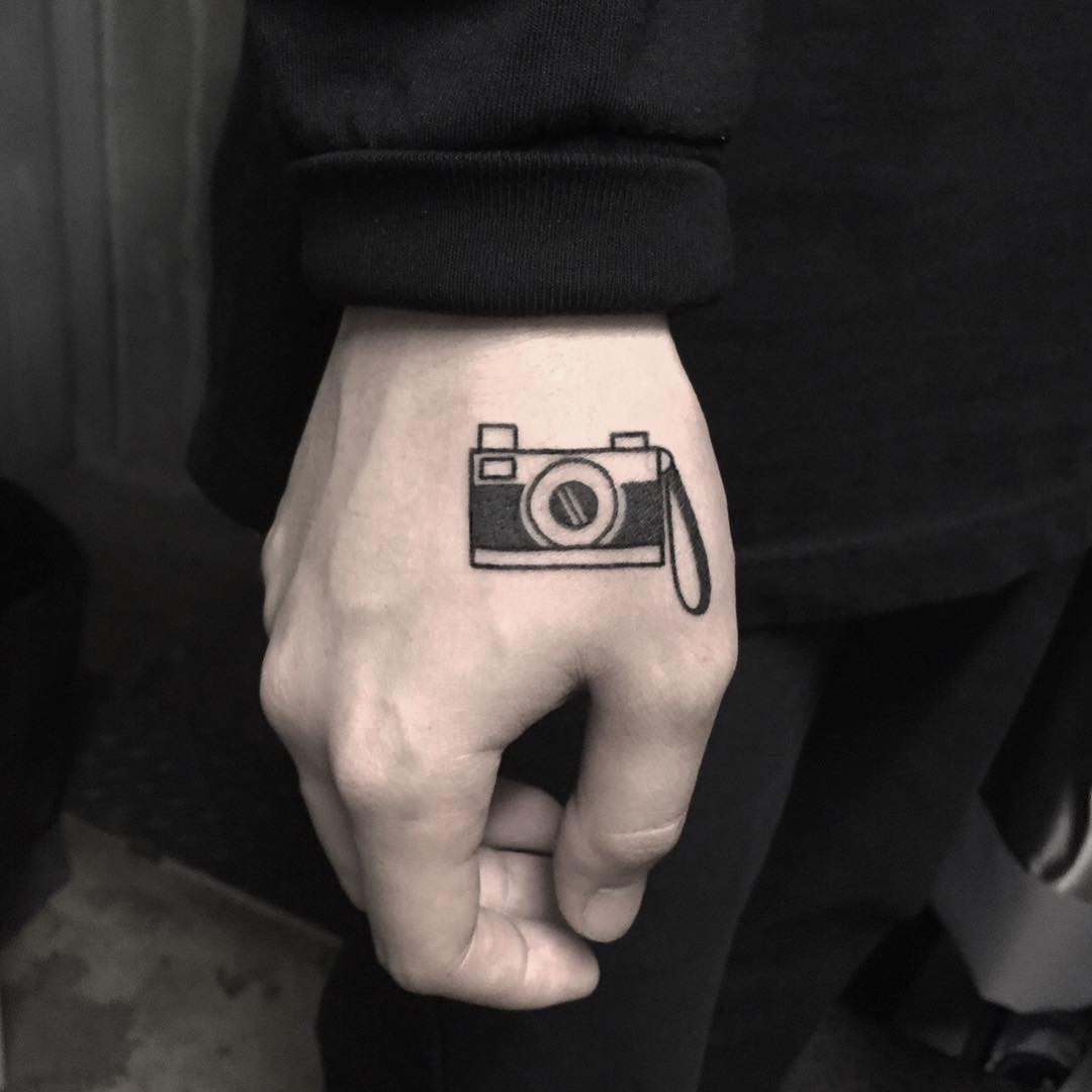 Photo camera tattoo by tattooist yeontaan