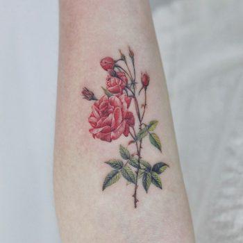Red flower tattoo by tattooist Nemo