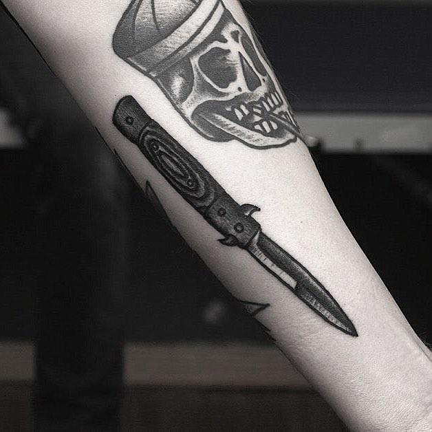 Sharp knife tattoo by Krzysztof Szeszko