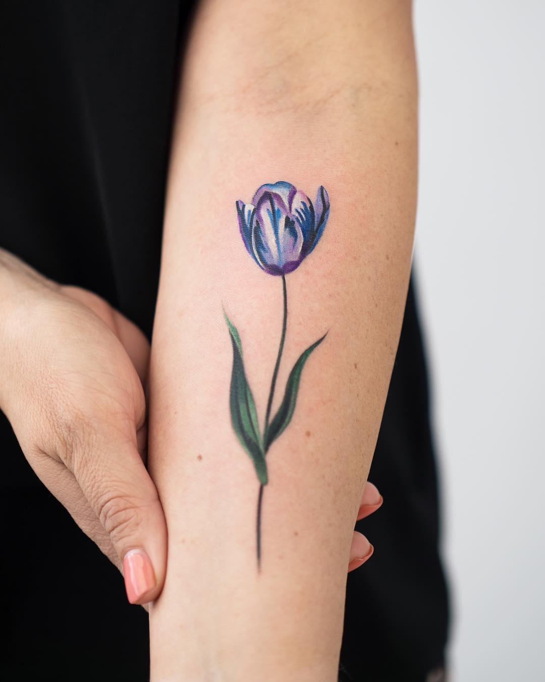 Tulip tattoo by Rey Jasper