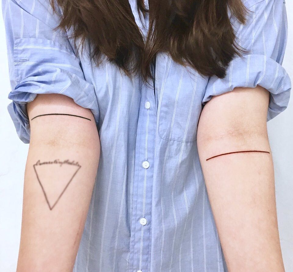 Two colored lines by tattooist Nemo