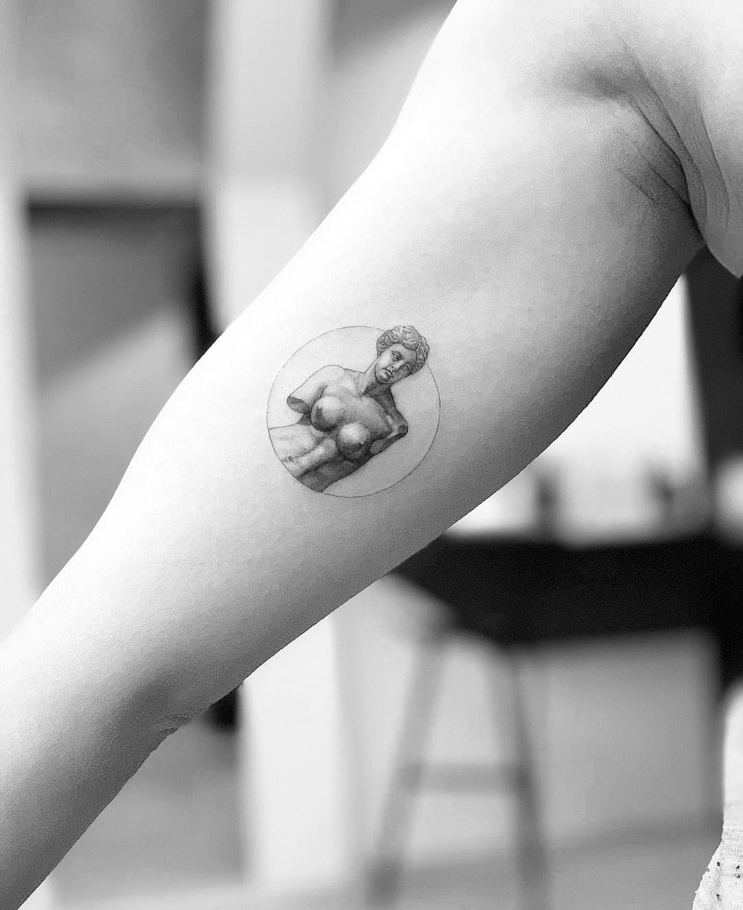 Venus statue tattoo by Dragon Ink