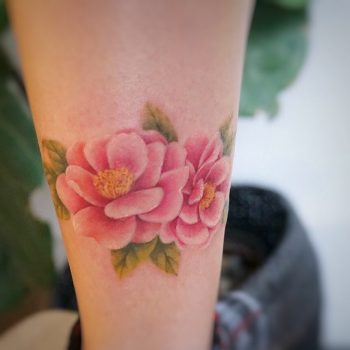 Watercolor camellia tattoo by tattooist G.NO