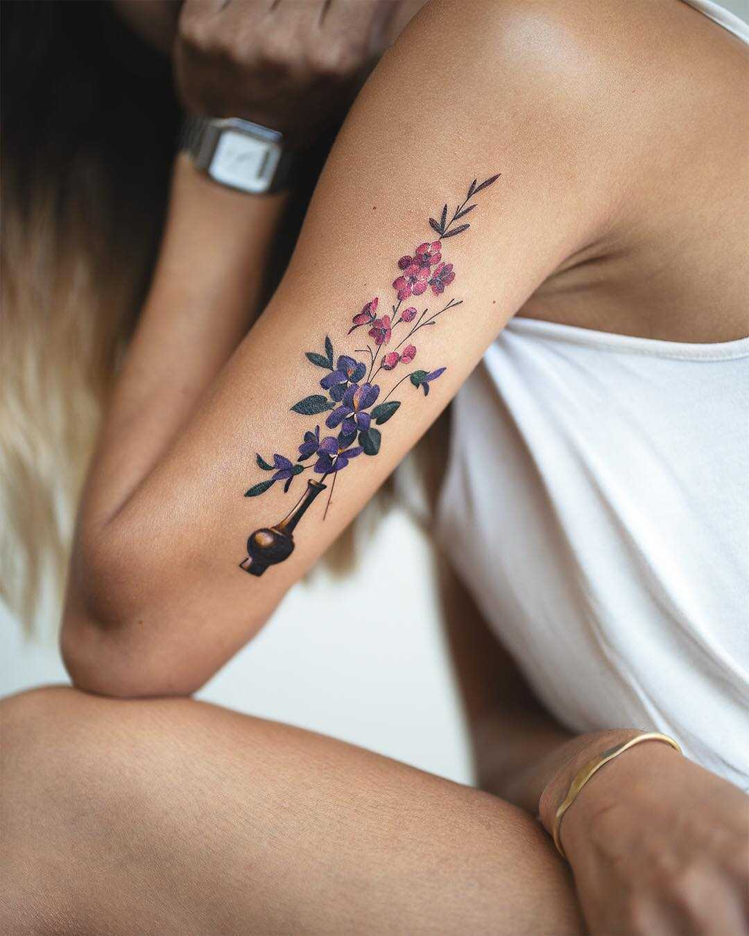 Beautiful flowers inked on the arm by Rey Jasper