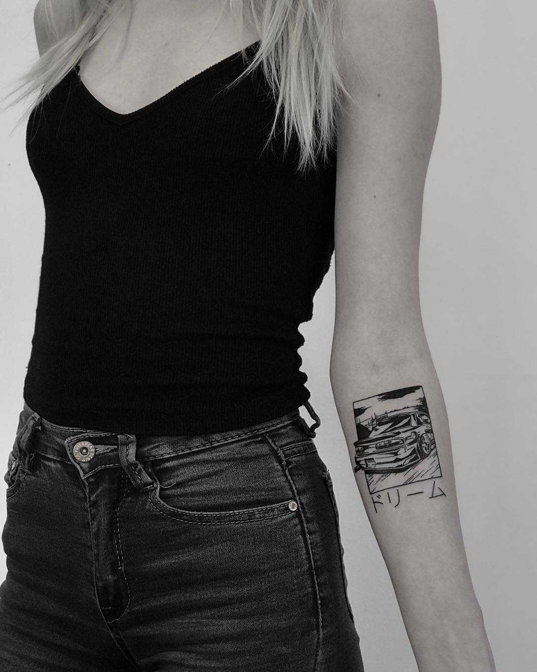 Black and white car tattoo by Krzysztof Szeszko