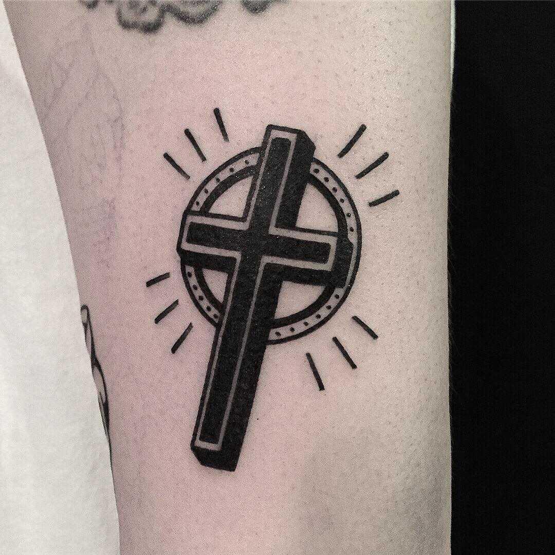Black cross by tattooist yeontaan