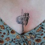 Brain, heart, and knife by tattooist Oozy