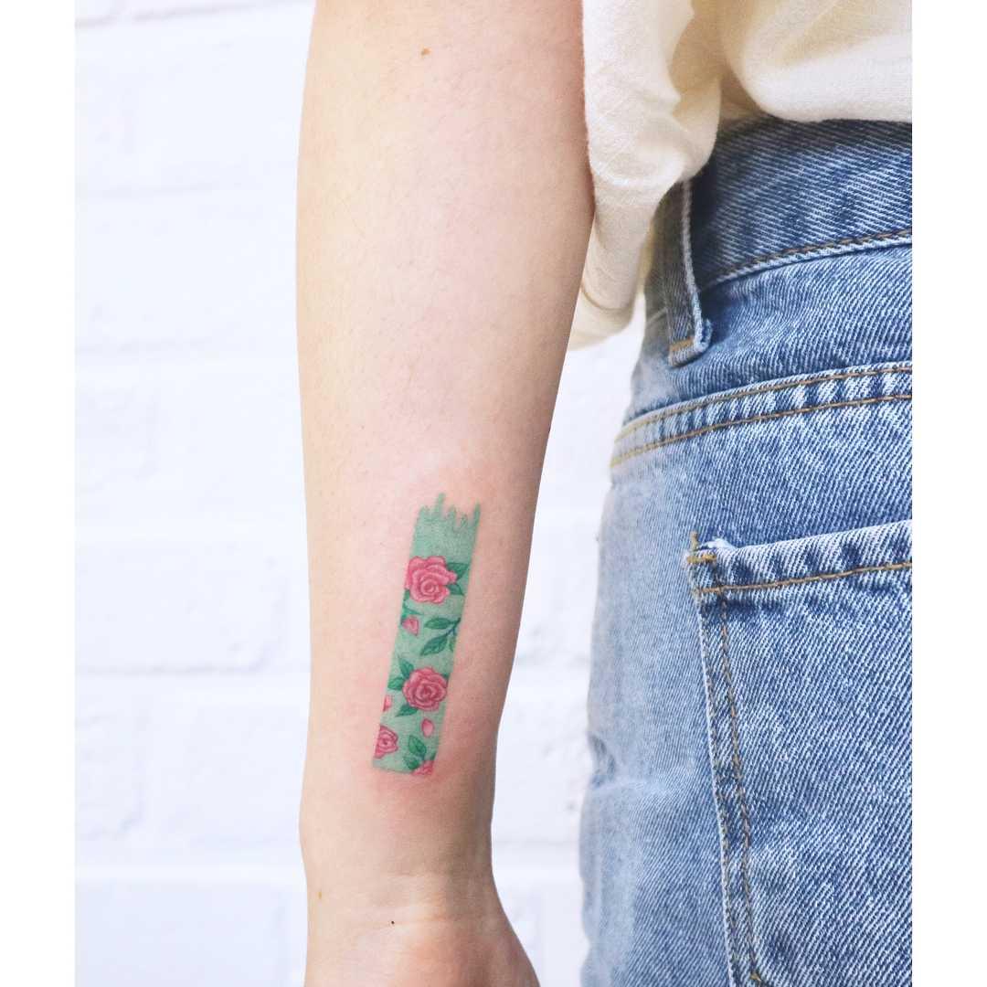 Castleton rose pattern tattoo by tattooist Nemo