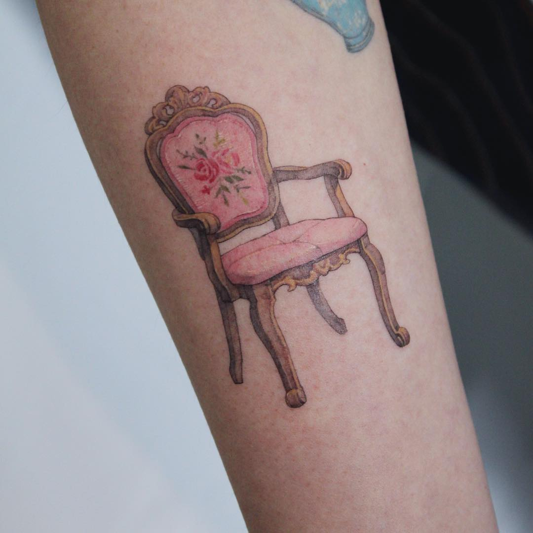Comfortable vintage chair tattoo by Mumi Ink