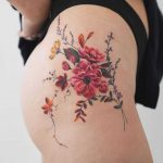 Delicate flowers on a hip by Rey Jasper