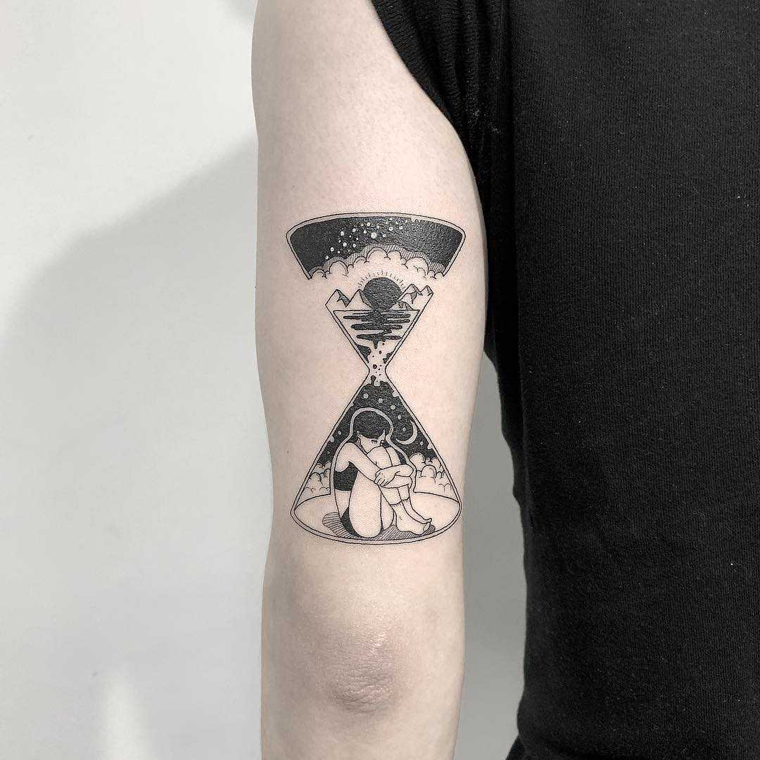 Double exposure hourglass by Nudy tattooer