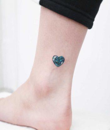 Emerald heart jewel by tattooist Nemo