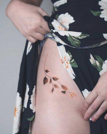 Gorgeous branch tattoo by Rey Jasper