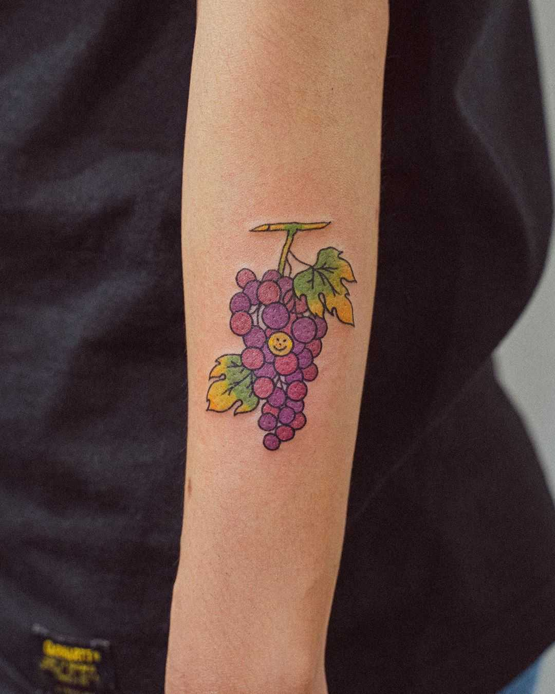 Grape branch tattoo by tattooist Bongkee