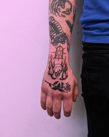 Hand tattoos by Tristan Ritter