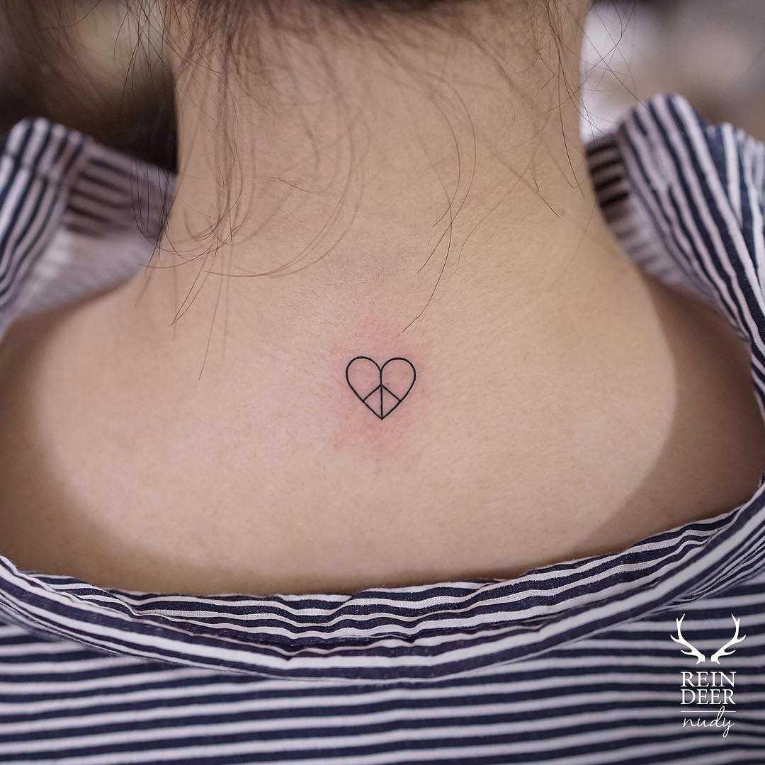 Heartpeace tattoo by Nudy tattooer