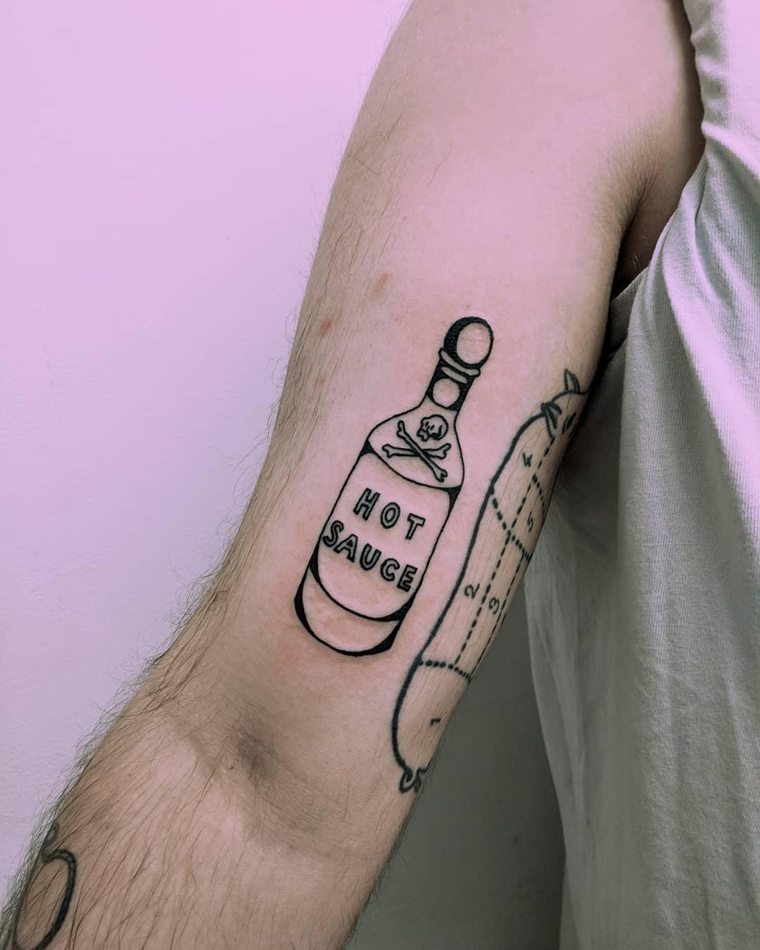 Hot sauce tattoo by Tristan Ritter