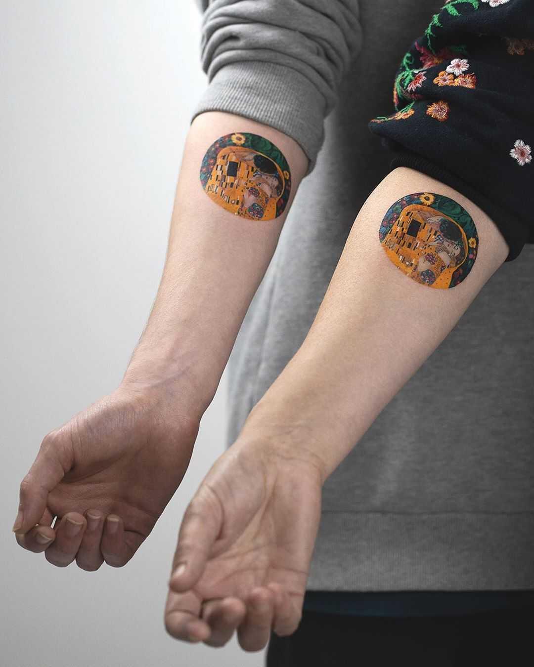 Klimt's matching tattoos by Rey Jasper