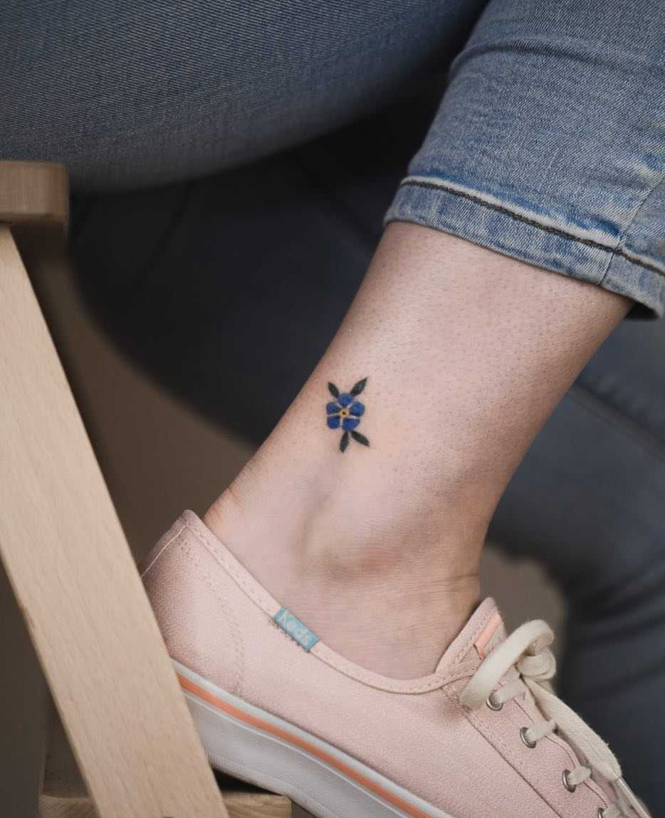 Little forget-me-not tattoo by Rey Jasper