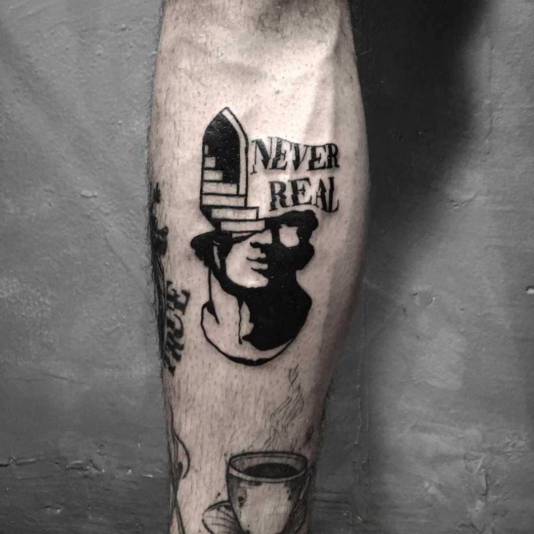 Never real by tattooist gvsxrt