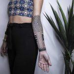 Ornamental forearm tattoo by Remy B