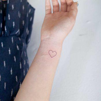 Outline heart by tattooist Nemo