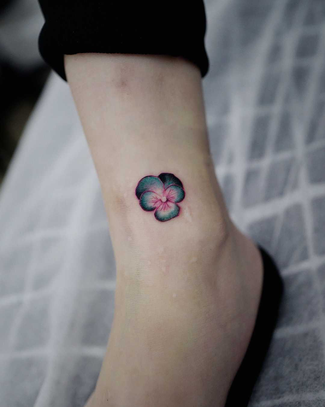 Pansy pendant tattoo by Studio Bysol