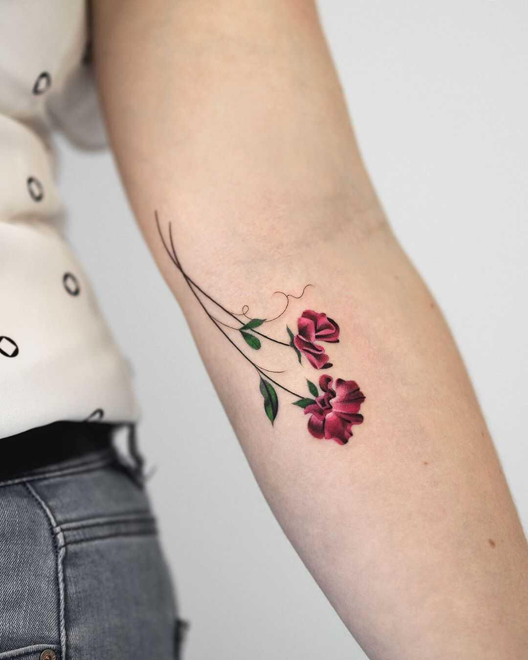Pea flowers tattoo by Rey Jasper