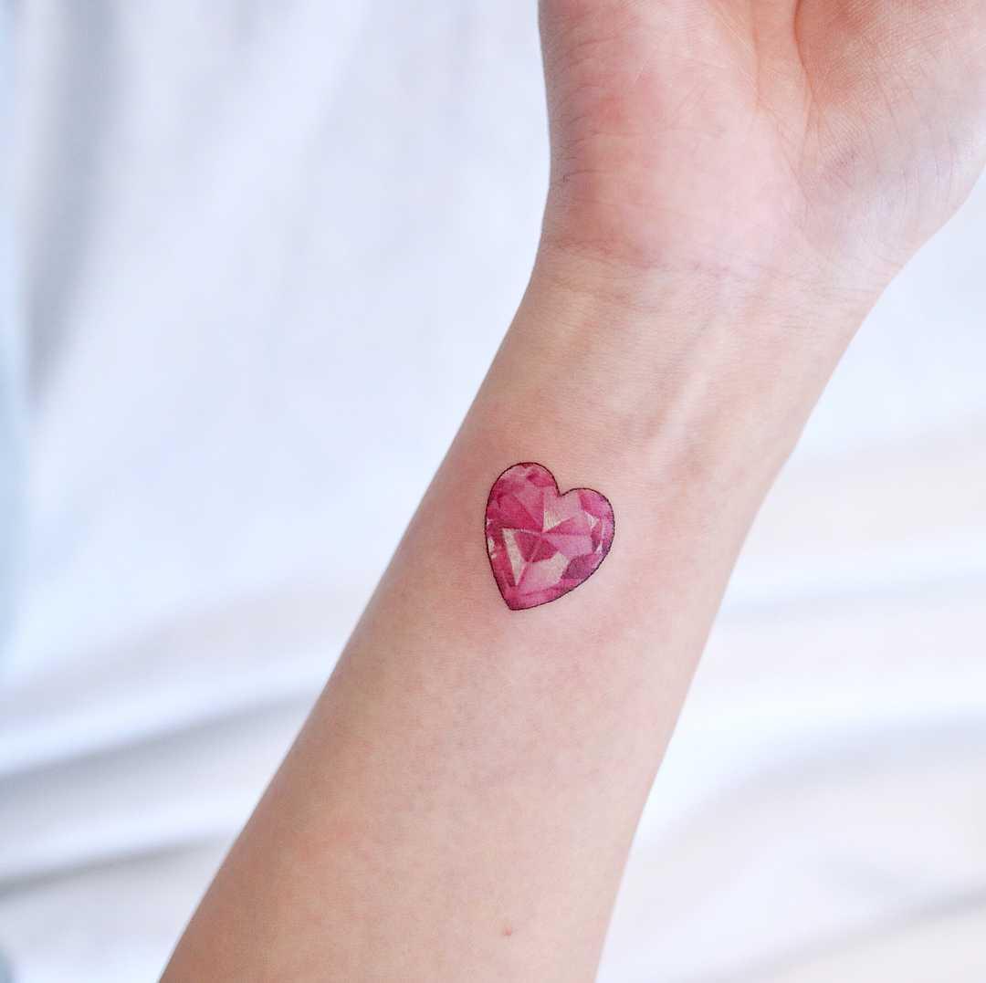 Pink crystal heart by tattooist Nemo