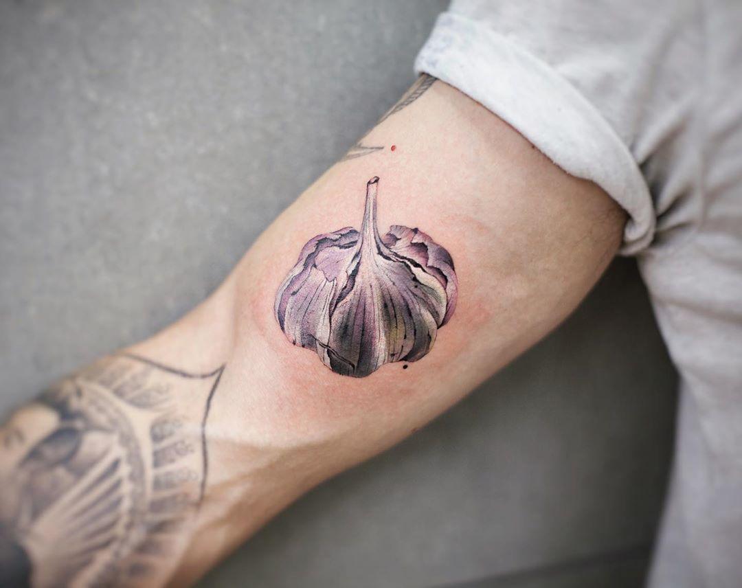 Purple garlic tattoo by tattooist Chenjie