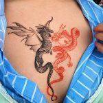 Red and black dragon tattoo by tattooist Oozy
