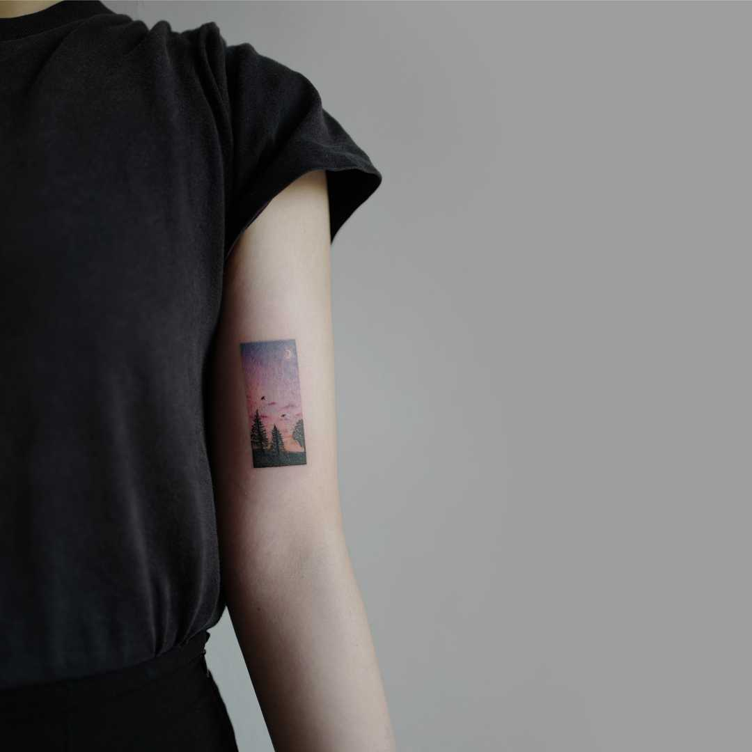Red rising sky tattoo by Studio Bysol