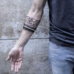 Sacred geometry armband tattoo by Remy B