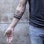 Sacred geometry armband tattoo by Remy B
