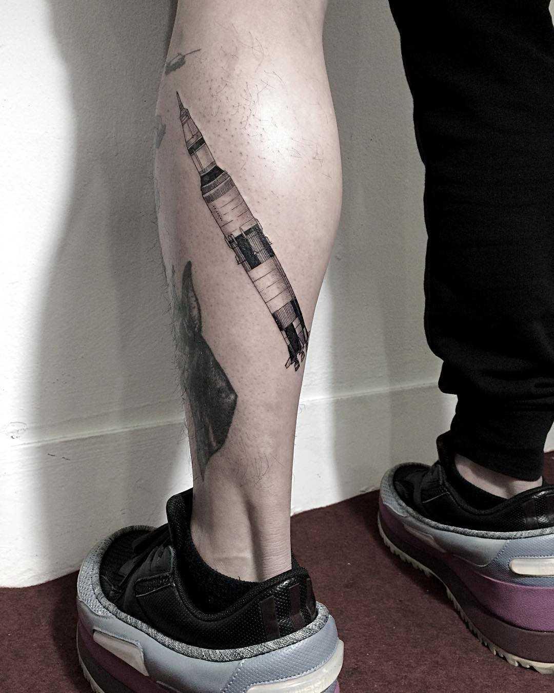 Saturn V tattoo by tattooist Oozy