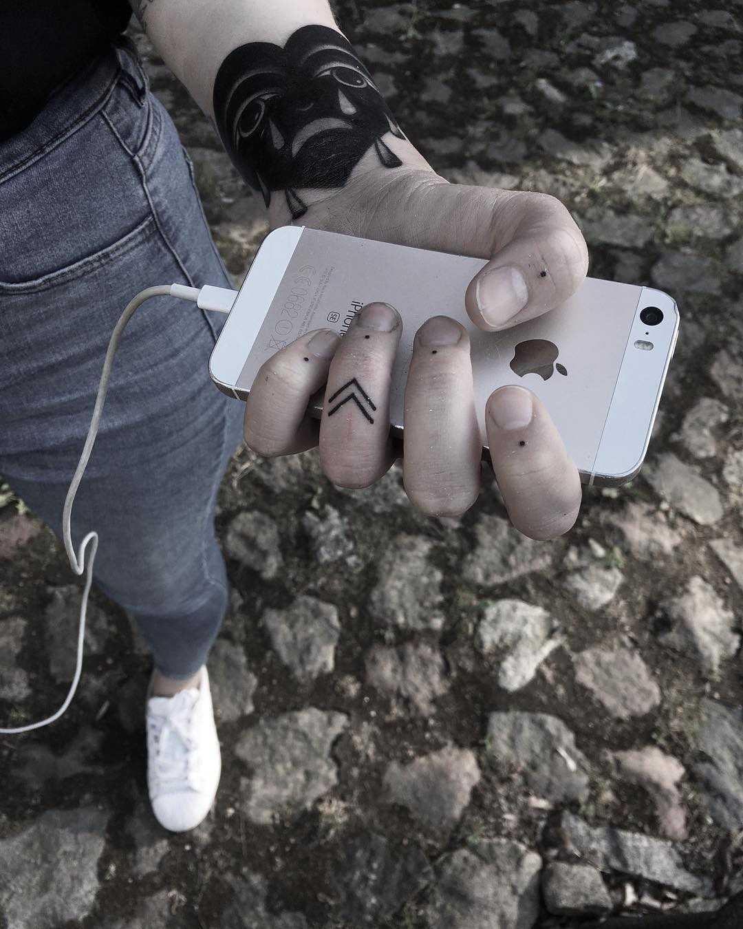 Small finger tattoos by Krzysztof Szeszko
