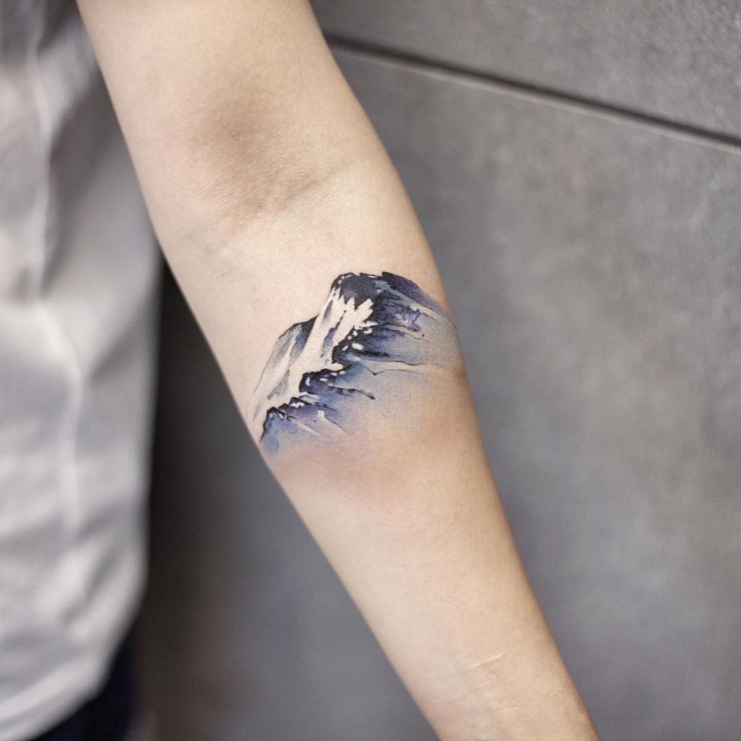 Snow mountain by tattooist Chenjie