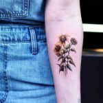 Sunflower tattoo by Dragon Ink