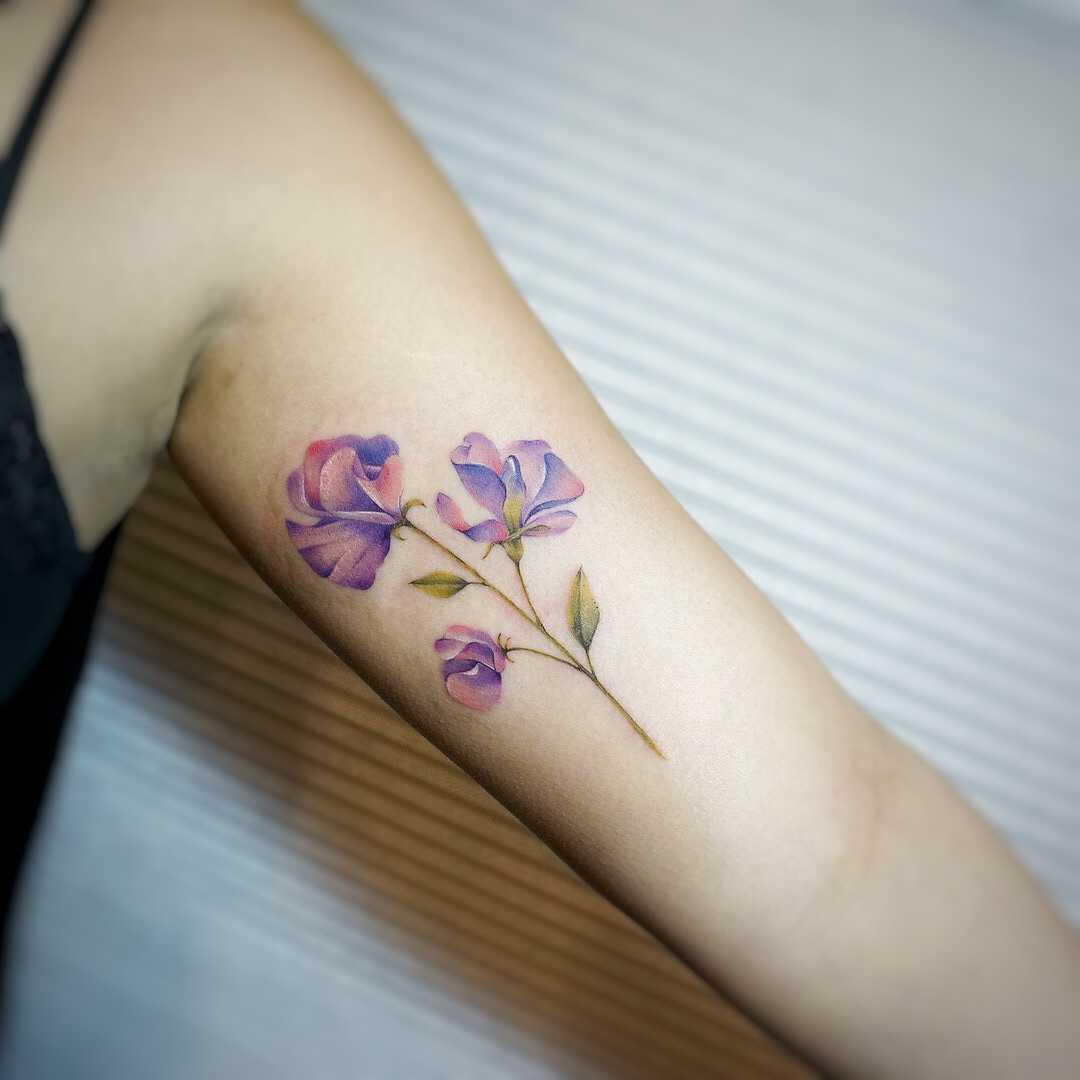 Sweet pea tattoo by tattooist G.NO