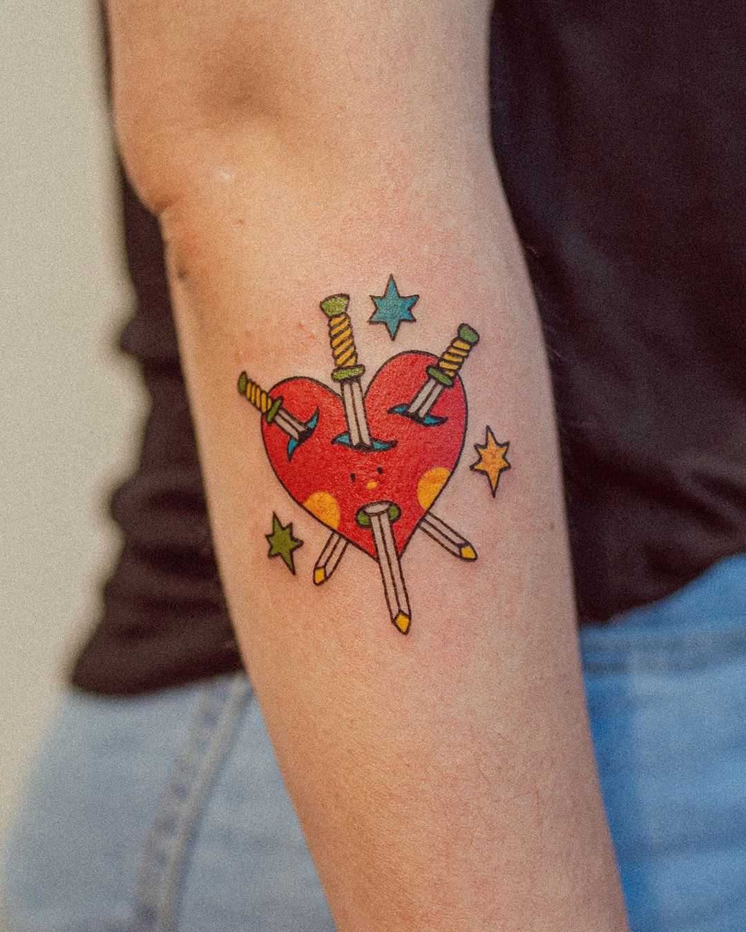 Swords and heart by tattooist Bongkee