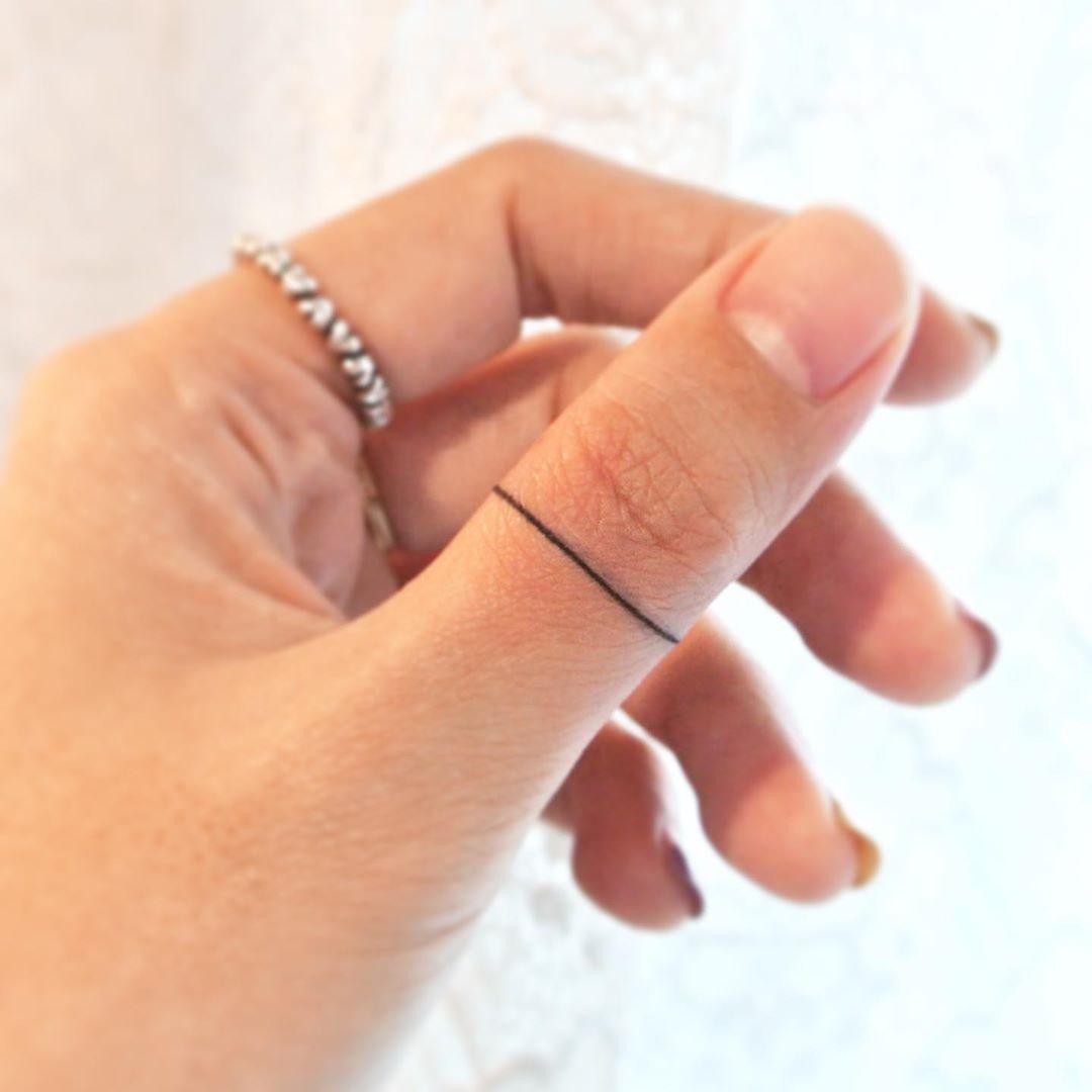 Thumb ring by tattooist Cozy