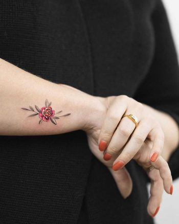 Tiny peony flower tattoo by Rey Jasper