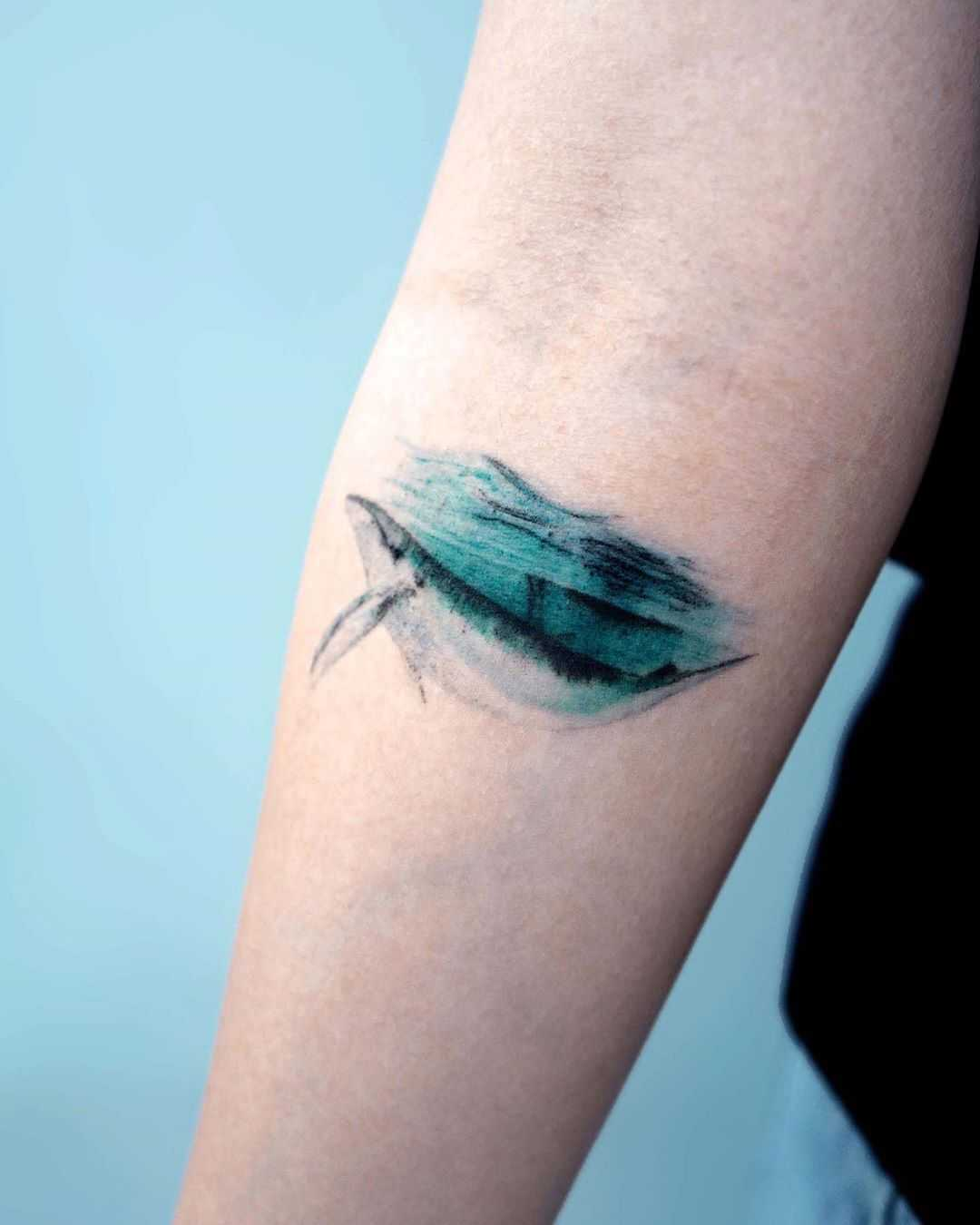 Watercolor whale tattoo underwater by Studio Bysol