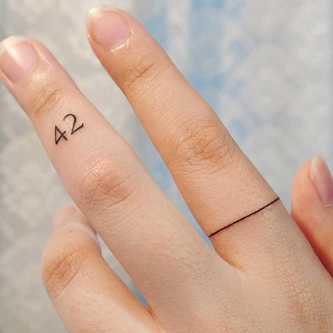 42 tattoo by tattooist Cozy