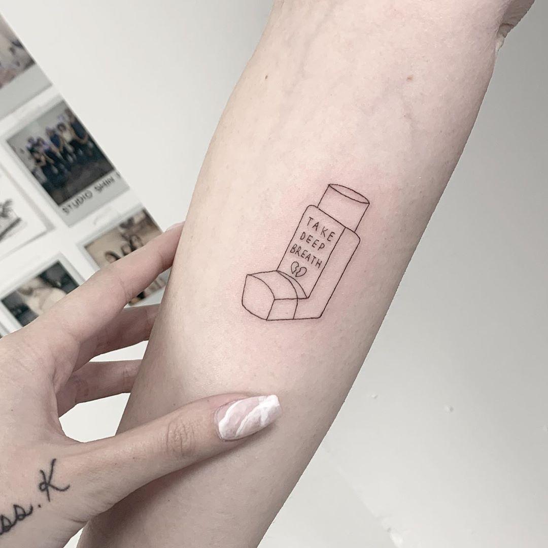 Asthma inhaler tattoo by Sara Kori