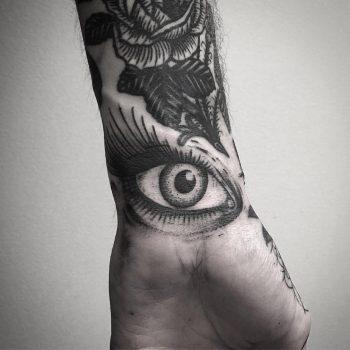 Black eye on a wrist by tattooist weepandforfeit