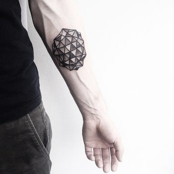 Black geometry on a forearm by Malvina Maria Wisniewska