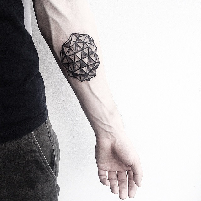 Black geometry on a forearm by Malvina Maria Wisniewska