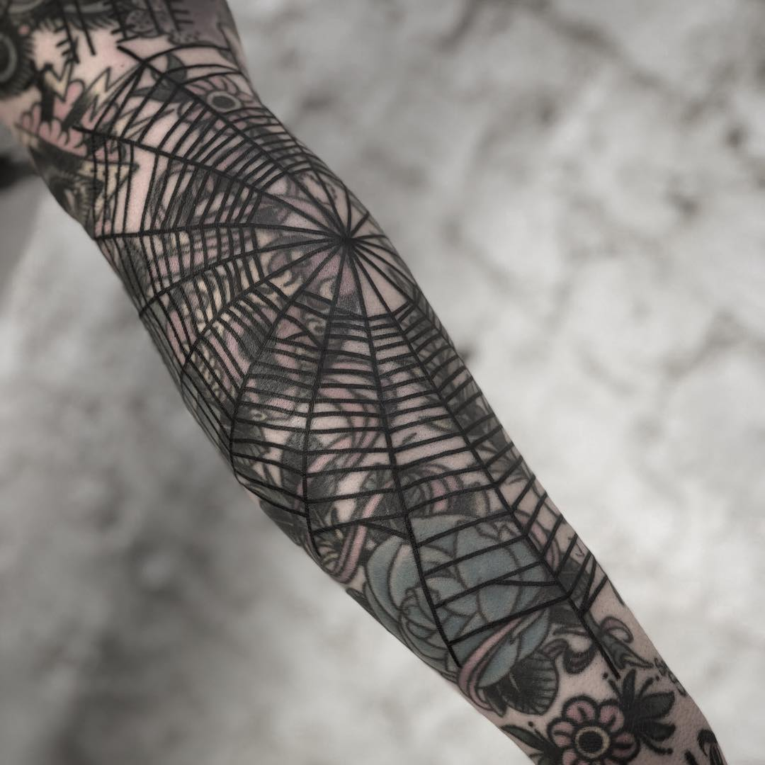 Black spider web by tattooist MAIC